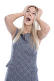 Business pressure: isolated frustrated pretty young woman is touching her head. stock photography