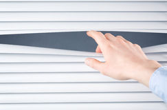 Business Privacy - Hand Opening Blinds Royalty Free Stock Photo