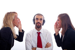 Business Problems. Businessman with Ear Protectors between Two Screaming Businesswoman Stock Images