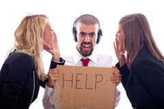 Business Problems. Businessman with Ear Protectors Hold Help Sign between Screaming Businesswoman Stock Photo