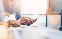 Business process photo. Account manager using mobile phone. Typing contemporary smartphone screen. Horizontal. Film and Royalty Free Stock Photography