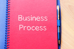 Business process write on notebook Royalty Free Stock Images