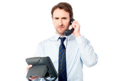 Business professional attending call Stock Photos
