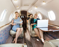 Business Professional In Corporate Jet Royalty Free Stock Photography