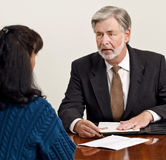 Business Professional Discussing Contract Stock Photo