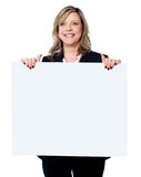 Business professional holding blank billboard Stock Images