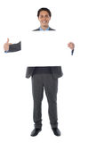 Business professional pointing an empty billboard Stock Images