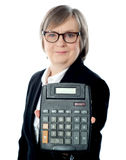 Business professional showing calculator to camera Stock Images