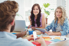Business professionals discussing in creative office Stock Image