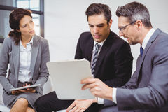 Business professionals holding documents on clipboard Stock Images