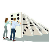 Business professionals pushing dominoes  Royalty Free Stock Photo