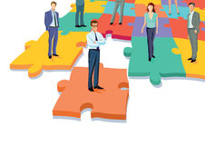Business professionals on puzzle pieces Royalty Free Stock Image
