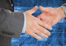 Business professionals shaking hands against coding background Royalty Free Stock Photography
