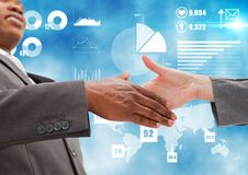 Business professionals shaking hands against networking icons in background. Digital composition of business professionals shaking hands against networking icons stock images