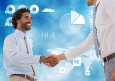 Business professionals shaking hands against technology background Stock Images