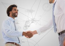 Business professionals shaking hands against technology background Royalty Free Stock Image