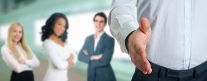 Business professionals shaking hands. Young people with business professionals shaking hands stock photos