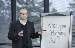 Business Professor leads a brain-storming discussion in a classroom Royalty Free Stock Photo