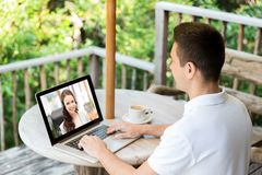 Man having video call with operator on laptop royalty free stock photo