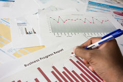 Business progress report. Reviewing business progress reports graphs Stock Photo