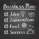 Business project sketch. Hand written business plan on black chalkboard Stock Image