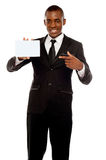 Business promoter pointing at blank placard Royalty Free Stock Image