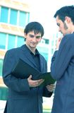Business Proposal. Two business men talking over a business proposal royalty free stock image