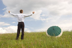 Business protection. Conception - businessman with umbrella Royalty Free Stock Image