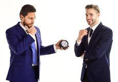 Business and punctuality concept. Businessmen misunderstanding a. Bout timing. Men in classic suits with opposite emotions stand on white background. Businessman royalty free stock images