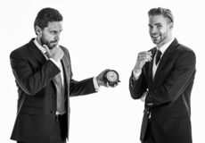 Business and punctuality concept. Businessmen misunderstanding a. Bout timing. Men in classic suits with opposite emotions stand on white background. Businessman stock image