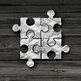 Business Puzzle Concept. As an abstract symbol for unity and connection as a jigsaw piece metaphor in a 3D illustration style Royalty Free Stock Image