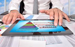 Business pyramid. Businessman hand touching digital tablet with business pyramid Stock Photo