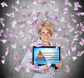 Business pyramid. Businesswoman holding digital tablet with business pyramid  and flying euro banknote Royalty Free Stock Photos