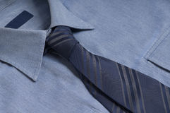 Shirt and Tie. High quality businessmans shirt with blank label and dark blue tie necktie on it Stock Image