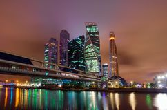 The business quarter of the city in multicolored illumination. A fantastic nighttime scene in Moscow. stock photos