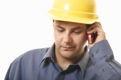 Business Quote. A man takes a phonecall on his cellphone Stock Images