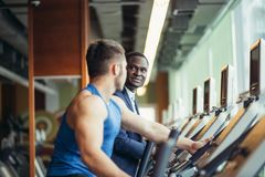 African businessman on the elliptical trainer. The business race. come first. African businessman on the elliptical trainer stock images