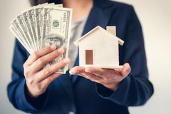 Free Business Real Estate And Residential Investment Concept, Broker Sell Agency Of Property Estates Showing Money And House Model To Royalty Free Stock Photo - 159233065