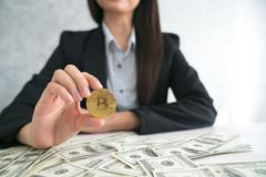 Business receive a lot of Money from Smartphone, Businessman Hol. Ding Bitcoin Royalty Free Stock Image