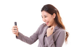 Business receiving good news from smartphone Stock Image
