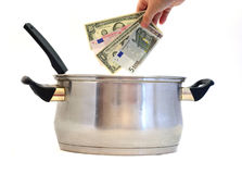 Business recipe. Money concept, cooking soup with currency Royalty Free Stock Photography