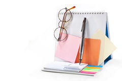 Business records. Leaflets for notes, pen, glasses on white background Royalty Free Stock Image