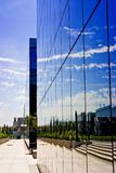 Business reflecting and modern. A business building made of reflecting windows. Was taken on a sunny day Royalty Free Stock Photography