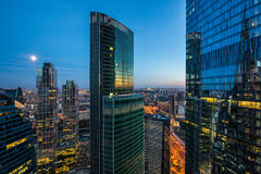 Business region. View of a city skyline at dusk with skyscrapers in the foreground Royalty Free Stock Photo