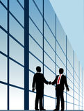 Business relationship handshake building window. Business people shake hands to agree on relationship or deal Stock Photo