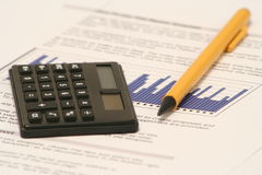 Business Report. Pencil and calculator on business report Royalty Free Stock Image
