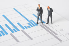 Business report analyze. Business report, graph and business figurines illustrating profit decrease analyze royalty free stock images