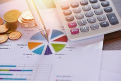 Business report chart preparing graphs calculator coin concept / Summary report in Statistics circle Pie chart stock photos