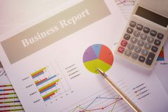 Business report chart preparing graphs calculator concept Summary report in Statistics circle Pie chart on paper business document royalty free stock image