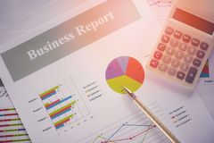 Business report chart preparing graphs calculator concept stock images